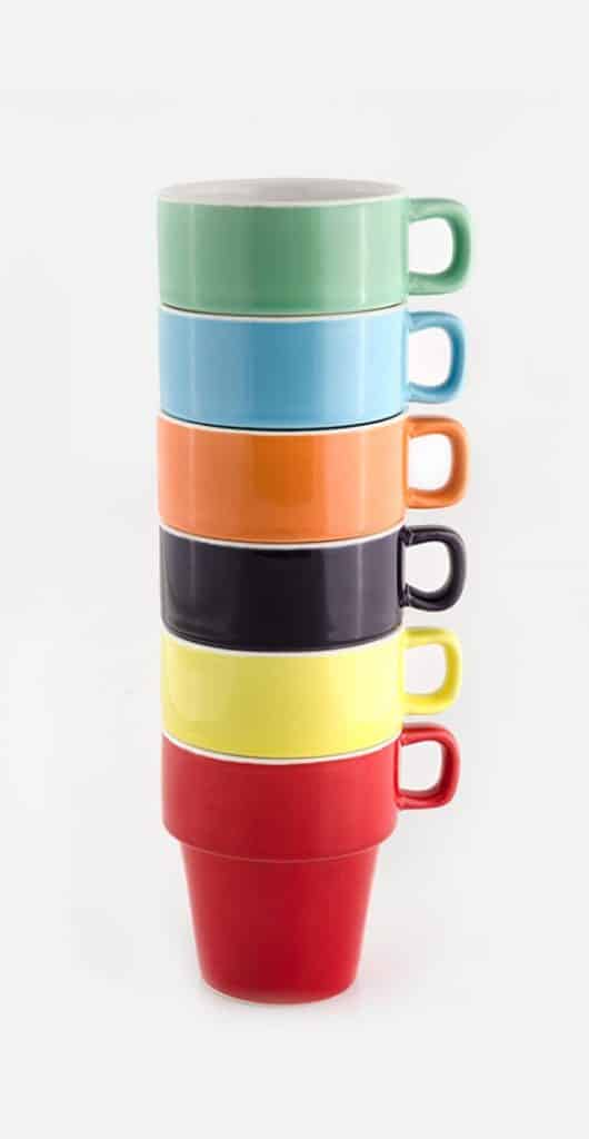 Six bright colourful mugs stacked on top of each other represents the embedding feature by gsphere.net
