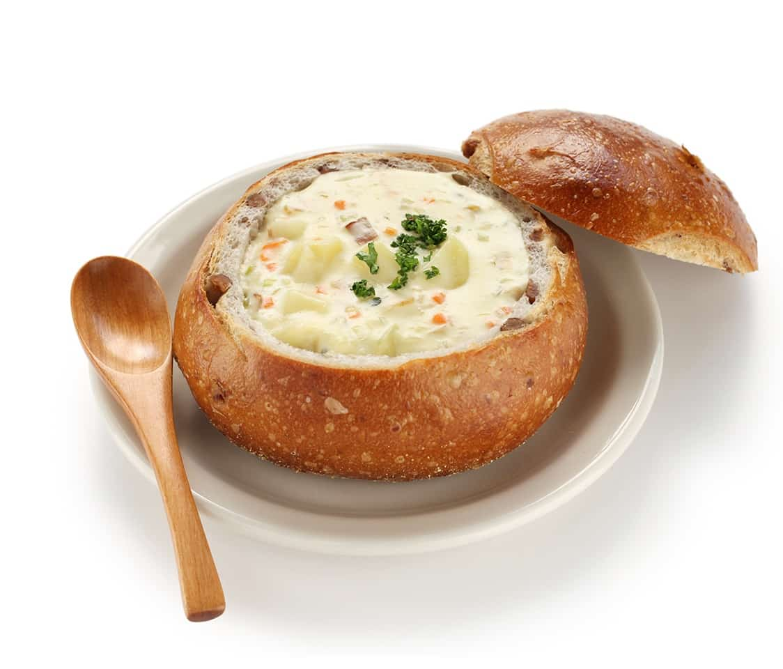 Clam chowder served in a bread loaf dipicting the free offering from gsphere.net